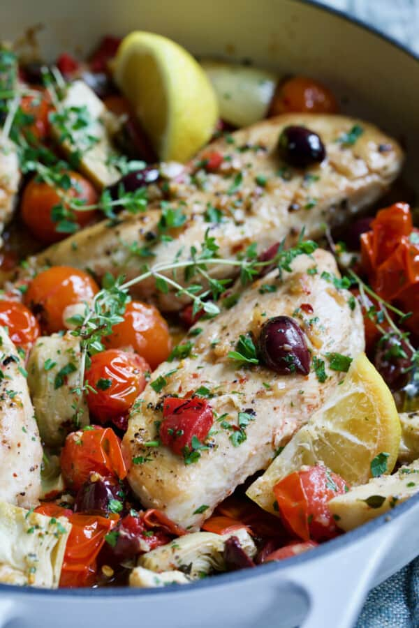 Close-up photo of one of the chicken breasts in Easy Skillet Mediterranean Chicken.