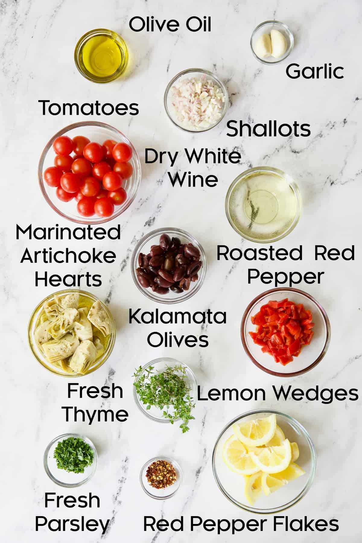 Ingredients for Easy Skillet Mediterranean Chicken in glass bowls.