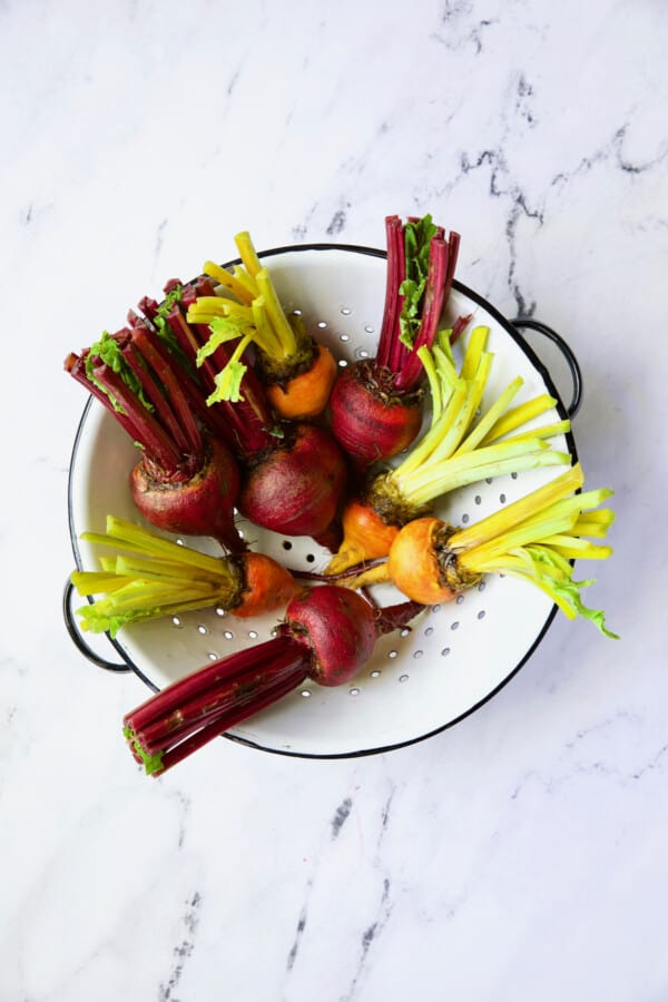 Photo of uncooked red and yellow beets.
