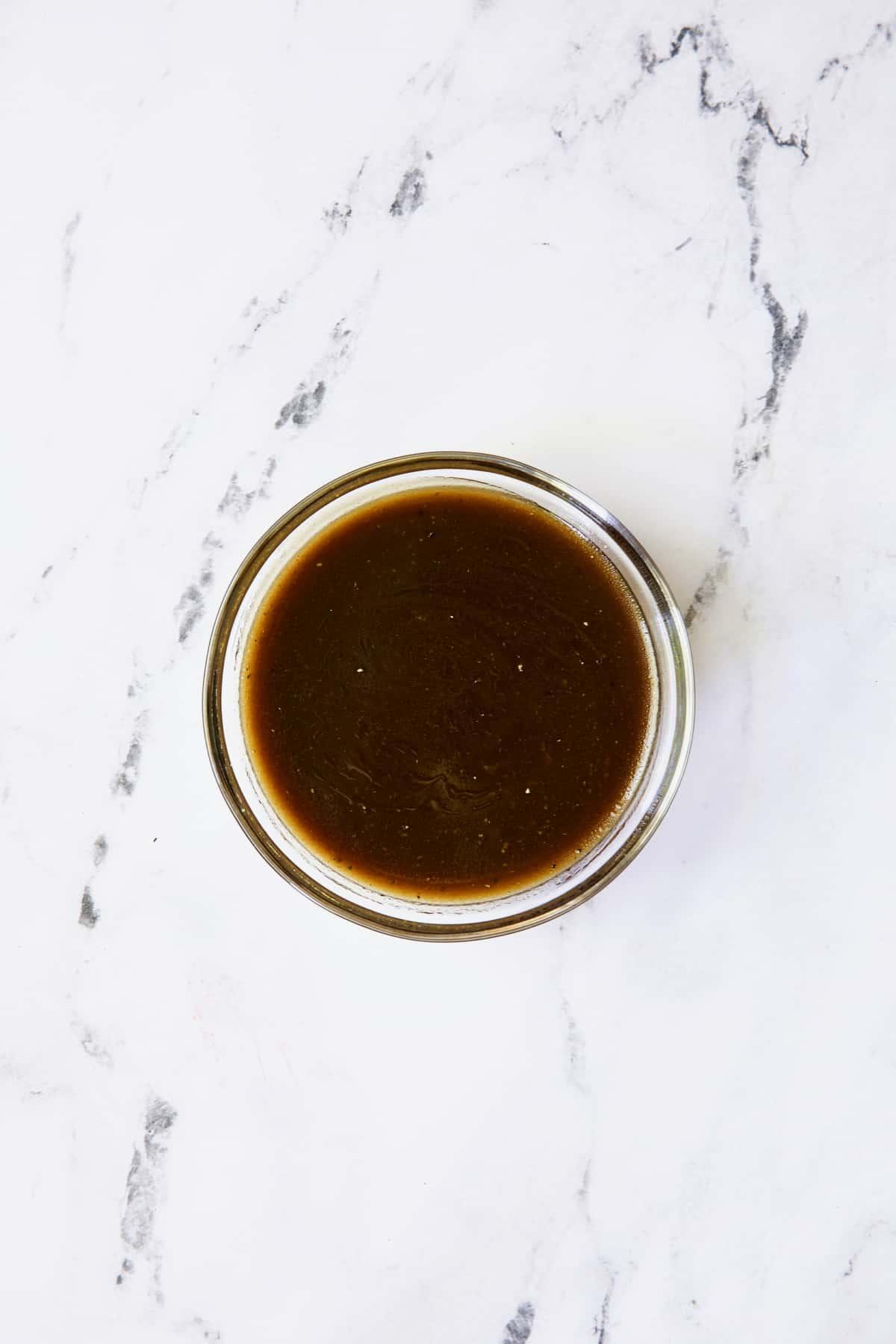 Honey Balsamic Dressing in glass bowl.