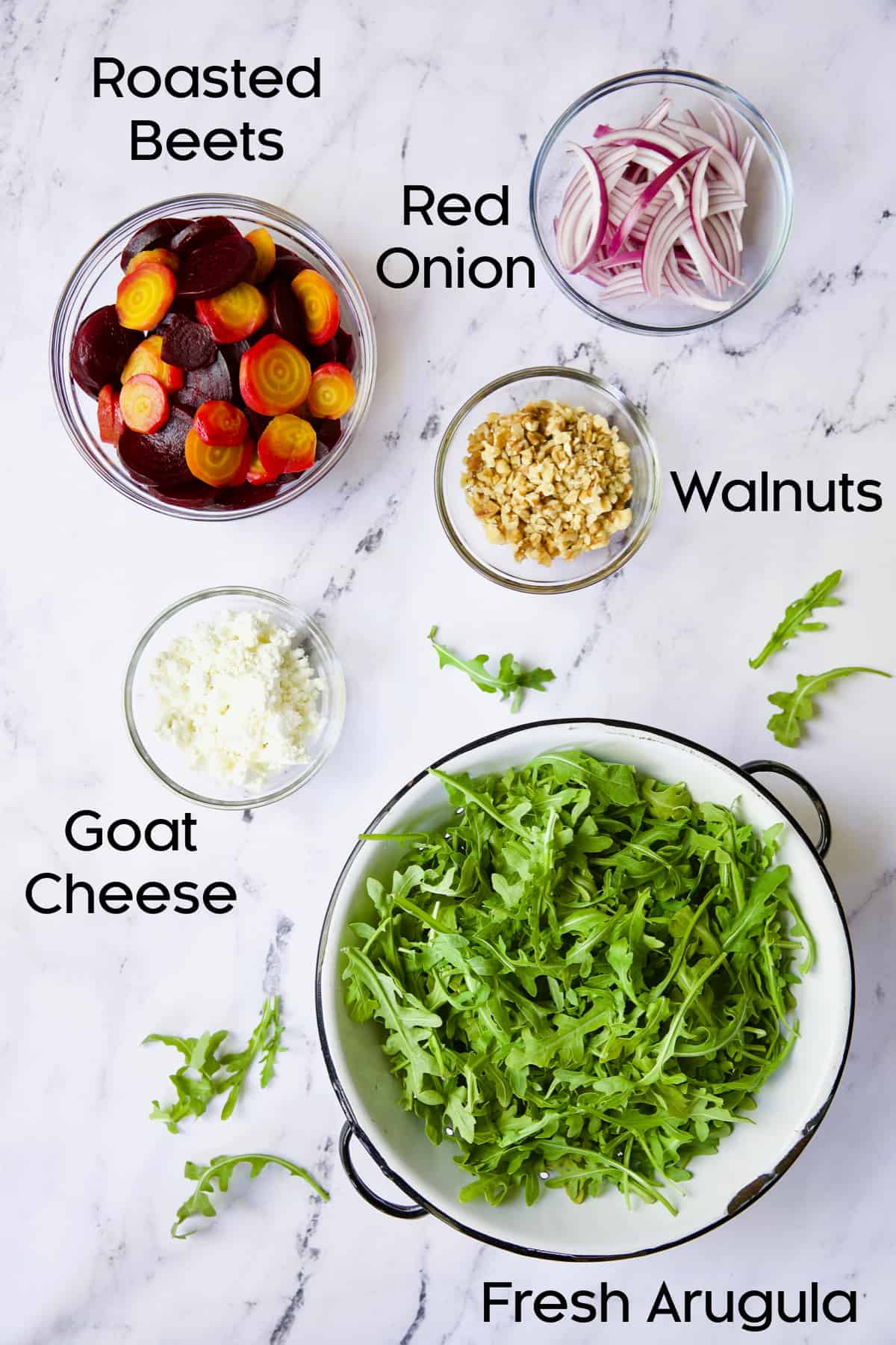Ingredients for Roasted Beet Salad with Walnuts Goat Cheese in glass bowls.