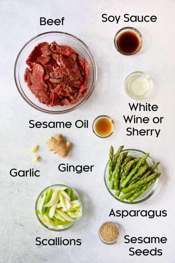Photo of ingredients for Sesame Beef and Asparagus Stir-Fry in glass bowls.