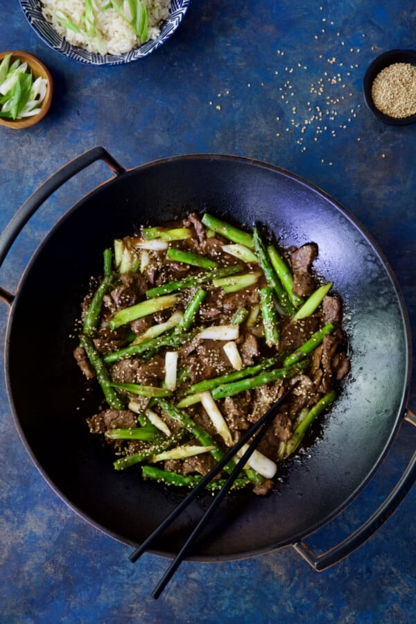 Photo of Sesame Beef and Asparagus Stir-Fry with black chopsticks.