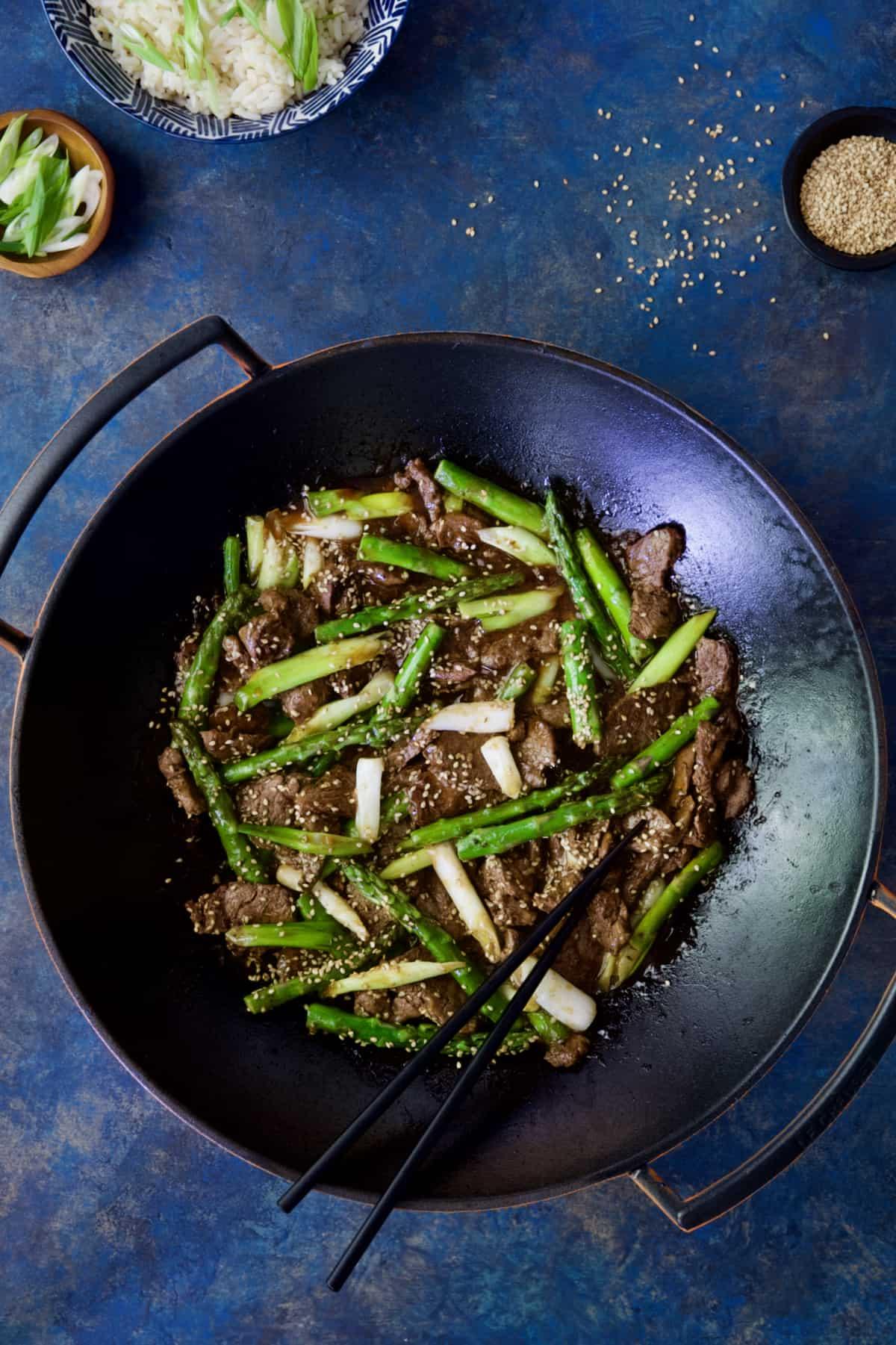 Sesame Beef and Asparagus Stir-Fry with black chopsticks.