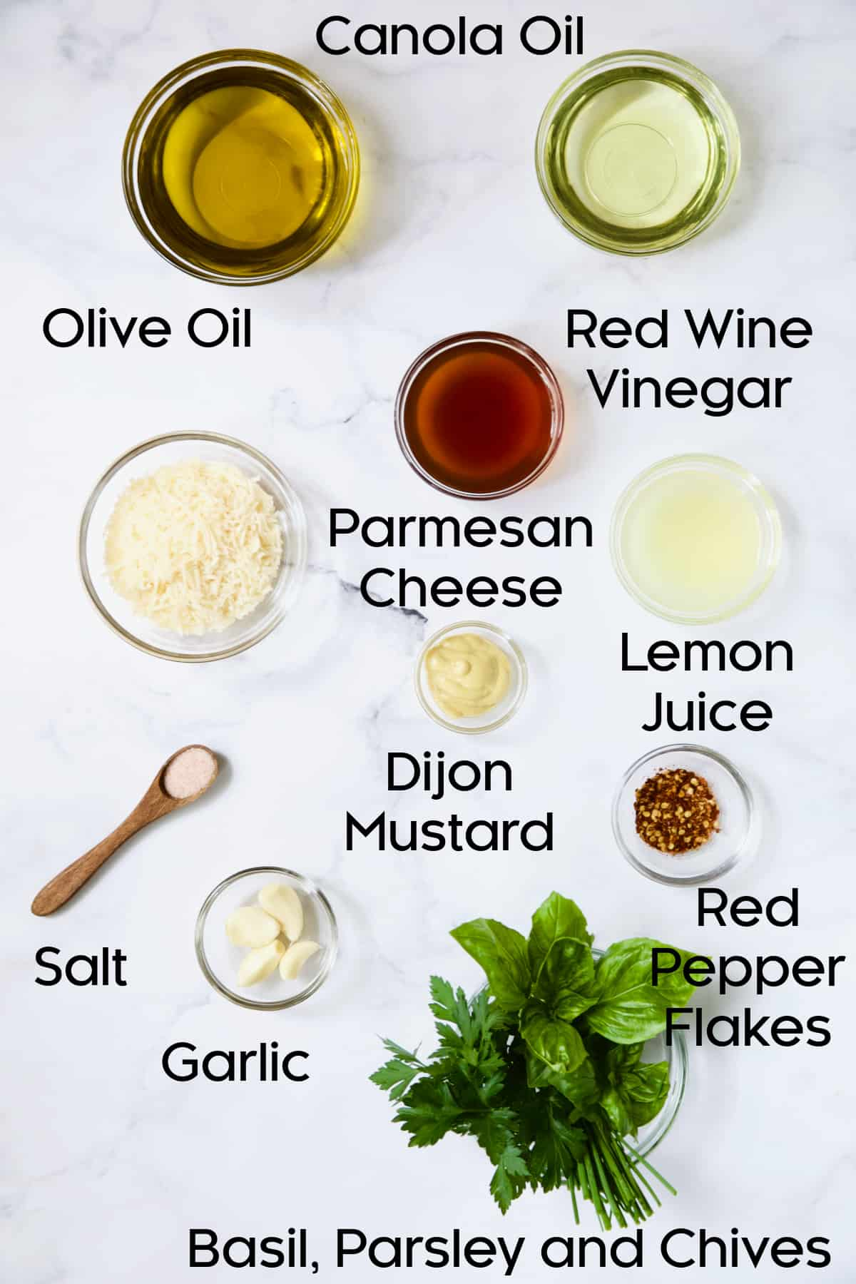 Ingredients for Parmesan Herb Vinaigrette in glass bowls.