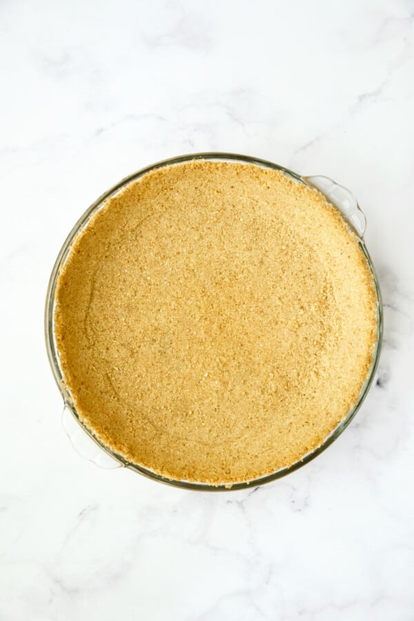 Process photo of unbaked graham cracker crust.