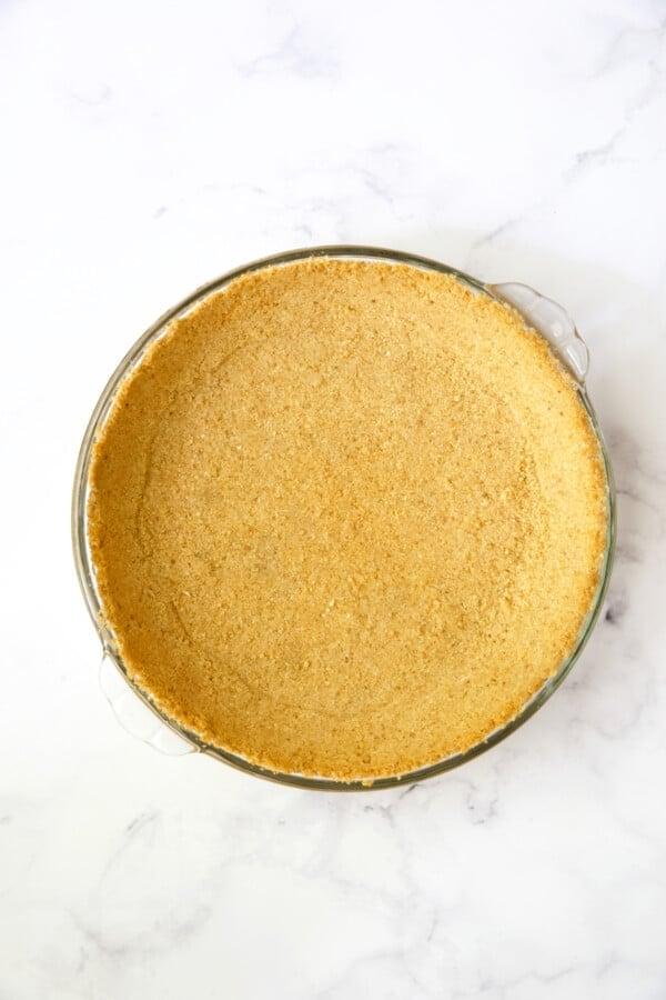Process photo of baked graham cracker crust.