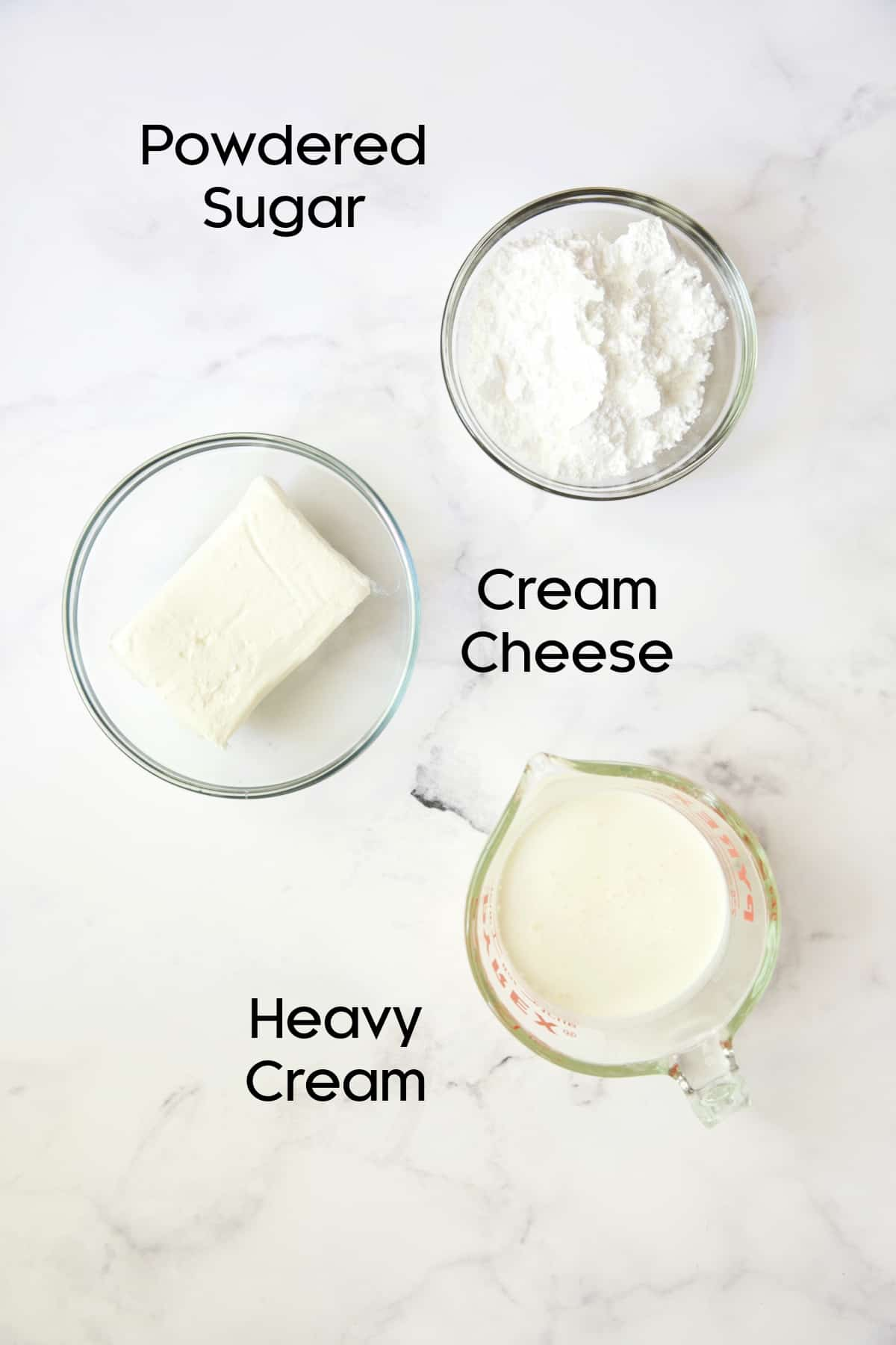 Ingredients for cream cheese layer in glass bowls.
