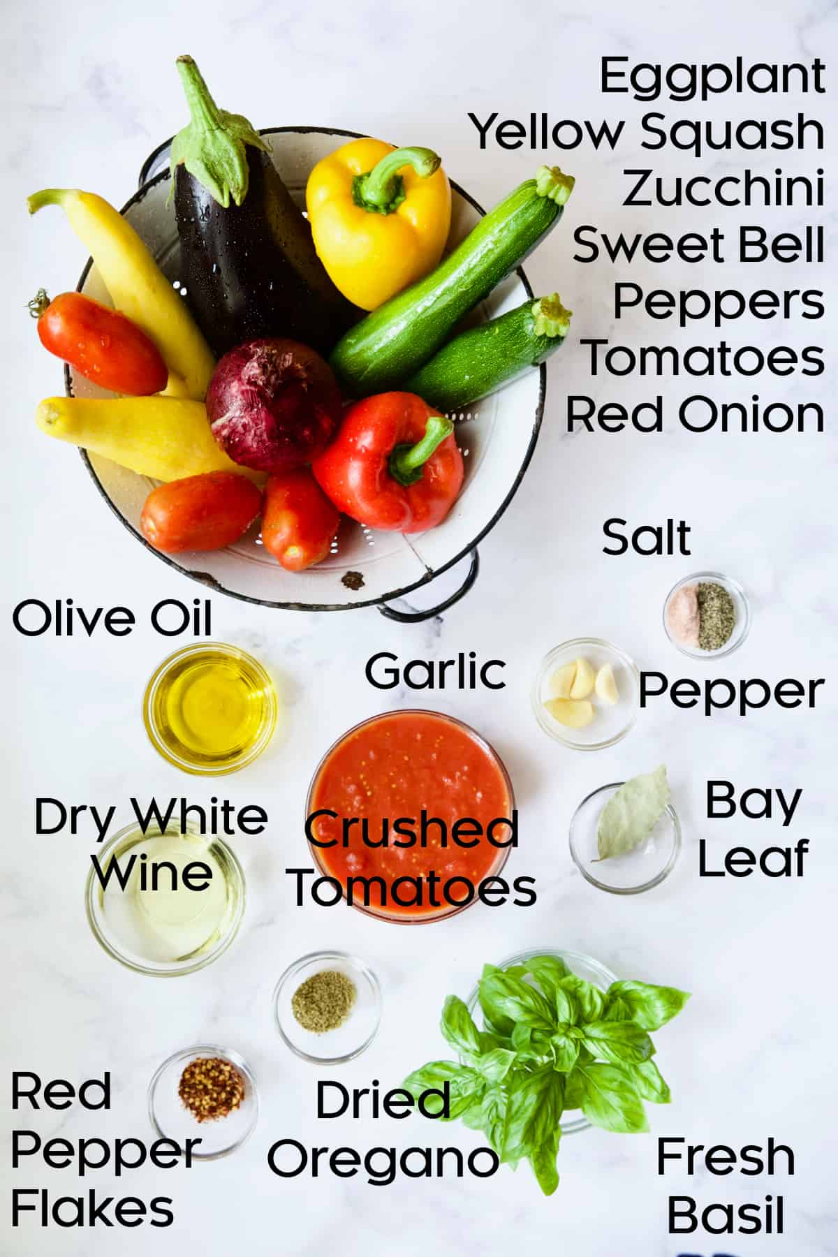 Ingredients for Classic French Ratatouille in glass bowls.