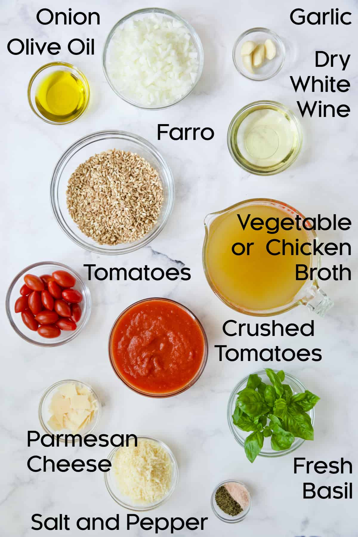 Ingredients for Tomato Farro Risotto with Basil and Parmesan in glass bowls.