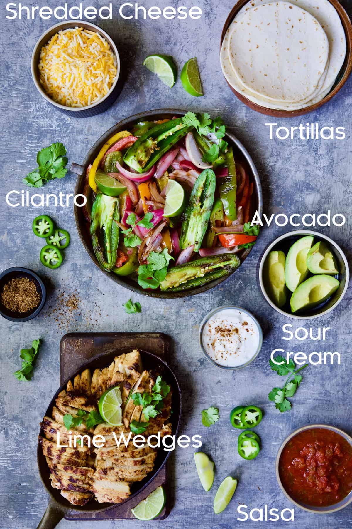 Ingredients for Grilled Tagin-Seasoned Chicken Fajitas on blue background.