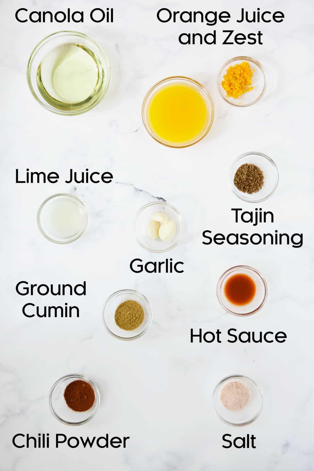 Ingredients for marinade for Grilled Tajin-Seasoned Chicken Fajitas in glass bowls.