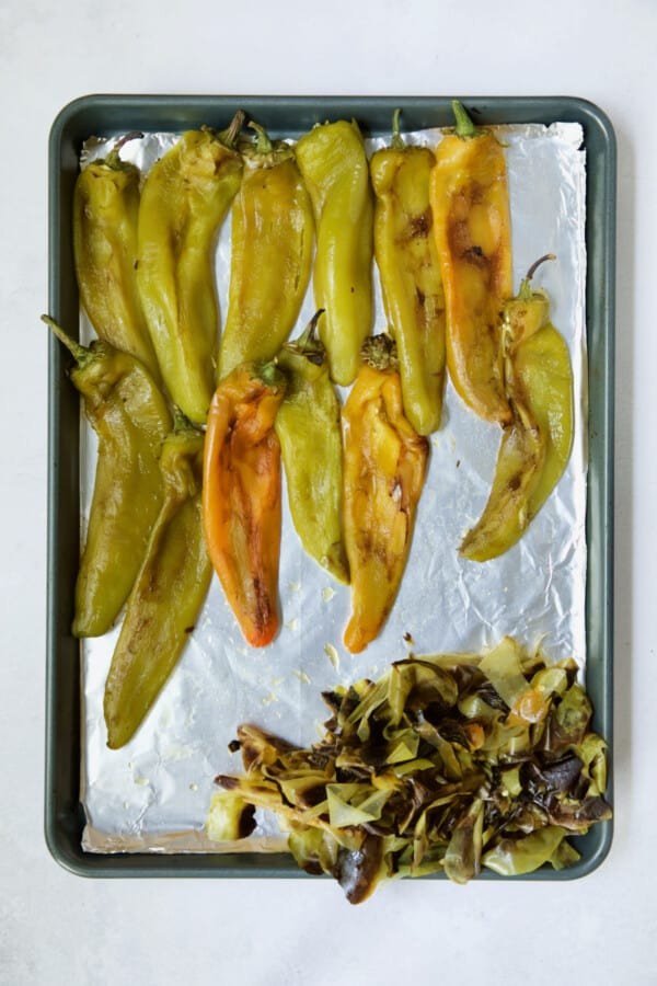 Roasted and peeled Hatch green chiles on rimmed baking sheet.