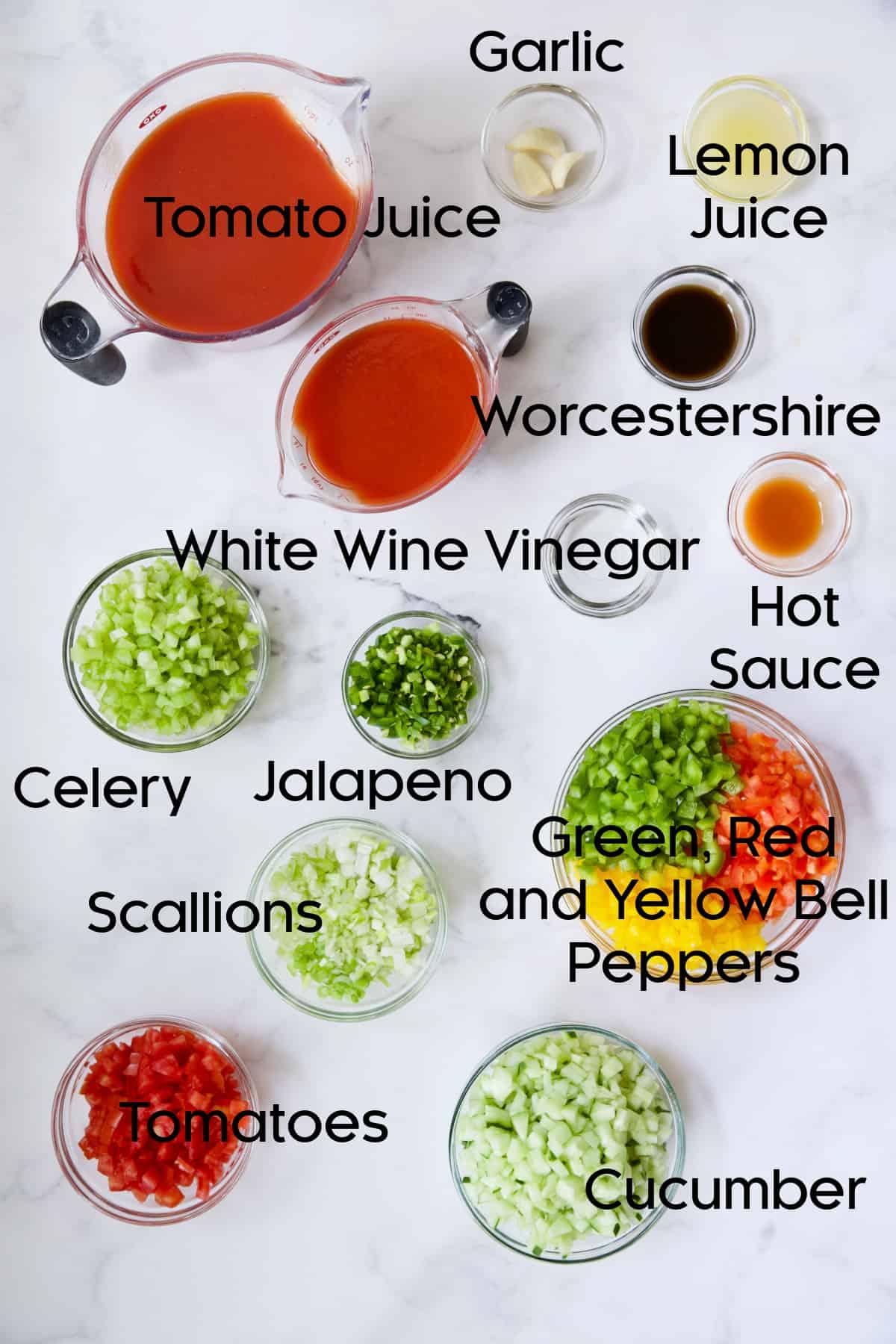 Ingredients for Very Veggie Gazpacho in glass bowls.