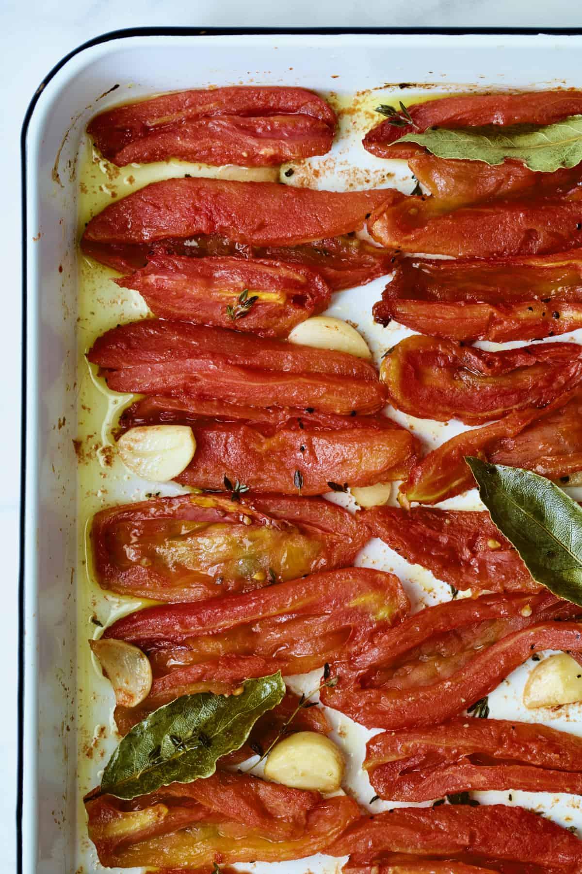 Tomato Confit on white enameled baking sheet.
