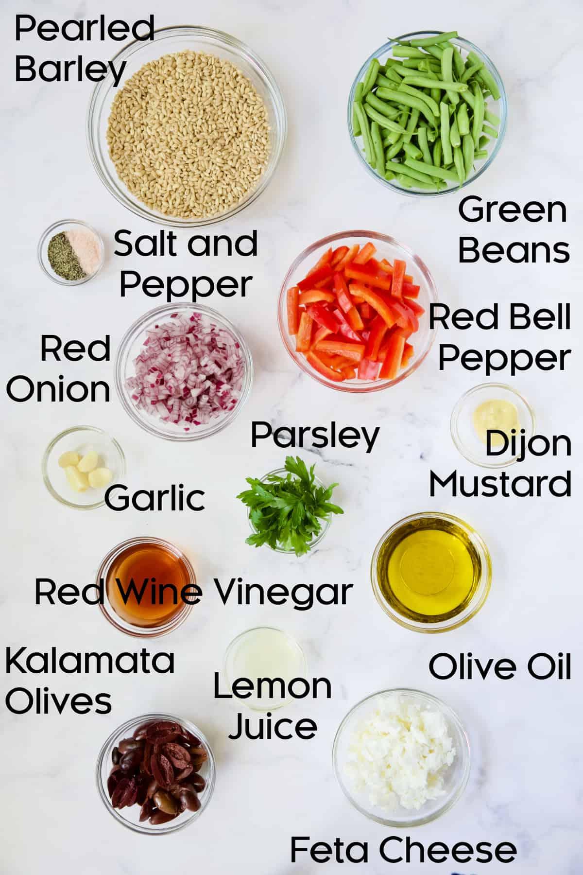 Ingredients for Mediterranean Barley Salad in glass bowls.